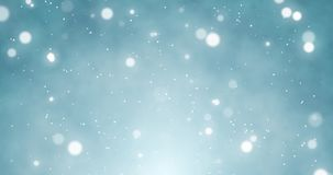 White confetti, snowflakes and bokeh lights on the blue Christmas background. White confetti snowflakes and bokeh lights on the blue Merry Christmas background stock footage