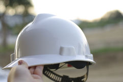 White construction hat on site Stock Photos