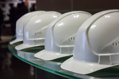 White construction helmets. On the tube rolling plant stock photo