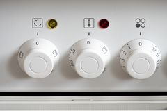 White control knobs at a electric oven Stock Photos