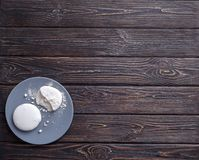 White cookies on blue plate Royalty Free Stock Images