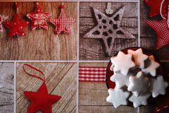 White cookies stars on red saucer on festive tablecloth with stars and wooden pattern. Royalty Free Stock Images