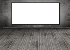 White copy space poster hung on a brick wall Royalty Free Stock Photo