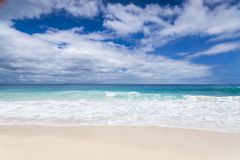 White coral beach sand and azure indian ocean. Royalty Free Stock Image