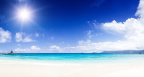 White coral beach sand and azure indian ocean. Royalty Free Stock Photography