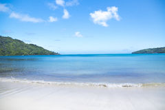White coral beach sand and azure indian ocean. Stock Image