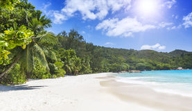 White coral beach sand and azure ocean. Seychelles islands. Royalty Free Stock Photo