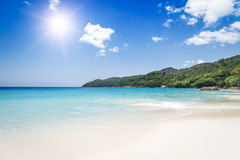 White coral beach sand and azure ocean. Seychelles islands. Royalty Free Stock Images