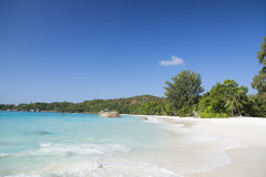 White coral sand and azure indian ocean. Stock Photography