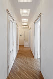 White coridor  with doors, in the apartment Royalty Free Stock Image