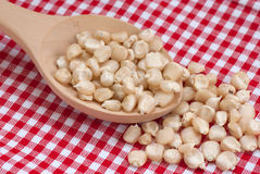 White corn. And wooden spoon on red tablecloth Royalty Free Stock Photo
