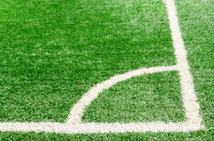 White corner field line on artificial green grass of soccer field. Artificial turf football field Stock Photo
