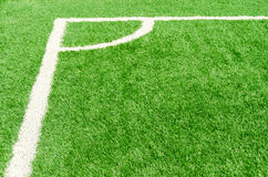 White corner field line on artificial green grass of soccer field Royalty Free Stock Photography