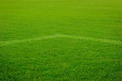 White corner line goal on grass soccer field. White corner line goal on green grass soccer field Royalty Free Stock Photo