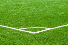 White corner marker on green sports turf. Royalty Free Stock Photos
