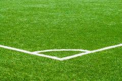 White corner marker on green sports turf. White corner line marker on green sports turf field Royalty Free Stock Photos