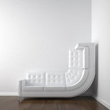 White corner room with couch Royalty Free Stock Images