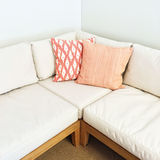 White corner sofa with pink cushions Stock Photography