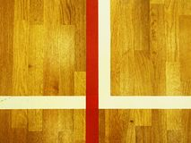 White corner. Worn out wooden floor of sports gym with colorful marking lines. Light reflections Royalty Free Stock Photo