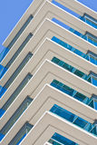 White Corners on Blue Building Royalty Free Stock Image