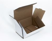 White Corrugated Box. Open white corrugated box over white Stock Image
