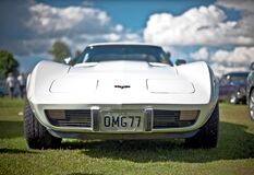 White Corvette C3 With Omg77 License Plate on Display Royalty Free Stock Images