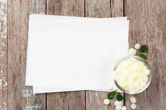 White cosmetic beeswax in bowl on blank recipe Stock Photo