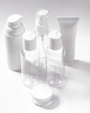 White cosmetic bottles on white background. Wellness, spa and body care bottles collection. Beauty treatment Stock Photography
