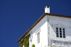 White Cottage stock photos