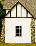 White Cottage. A white-walled cottage with stone Royalty Free Stock Photo