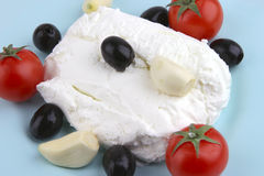 White cottage cheese with olives and cherry Stock Photography