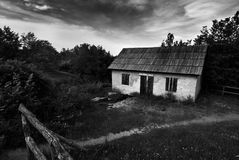 White cottage in countryside Royalty Free Stock Images
