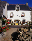 White cottage with hanging baskets, Brittany, France Stock Images