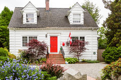 White Cottage with Red Door in Canada Stock Photo