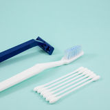 The white cotton buds with toothbrush and plastic razor. Stock Photography