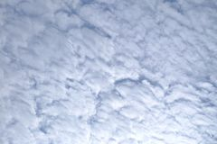 White cotton candy clouds against blue sky. High space for background backdrop royalty free stock images