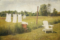 White cotton clothes drying on a wash line. With vintage feel Stock Photos
