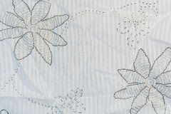 The white cotton fabric with a black floral pattern Royalty Free Stock Photos