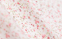White cotton fabric with pink floral pattern. Closeup Stock Photo