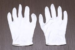 White cotton gloves Stock Photography