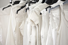 White cotton ladies tops on hangers Royalty Free Stock Photo