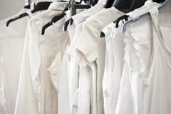 White cotton ladies tops on hangers Royalty Free Stock Photo