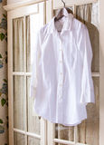White cotton shirt on a hanger Royalty Free Stock Photo