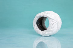 White cotton string ball on blue background Stock Photography