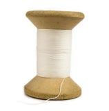 White cotton thread. Wooden spool of white cotton thread Stock Photos
