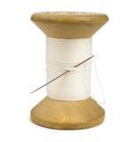 White cotton thread. Wooden spool of white cotton thread with needle Royalty Free Stock Photos