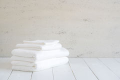 White cotton towels use in spa bathroom on wood background. Stock Photography