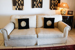 White couch with black cushions Royalty Free Stock Photography