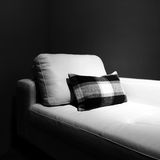 White couch in a dark room Stock Images