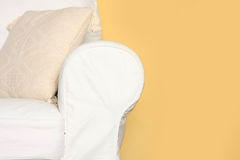 White couch near yellow wall Royalty Free Stock Image